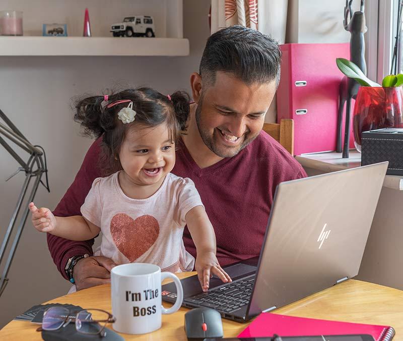 Kris at work with daughter Eva